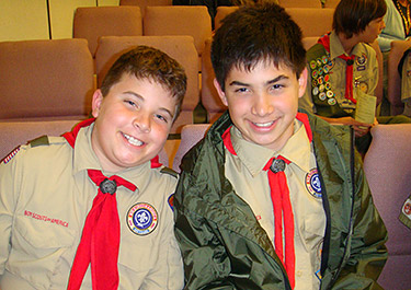Ramon and Andres smiling, wearing Boy Scout uniforms
