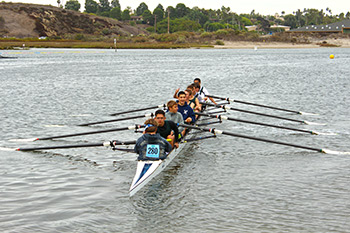Ramon and his teammates rowing