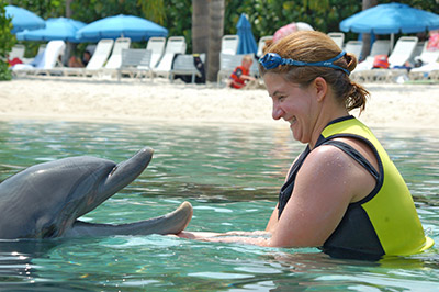 Dr Coppa playing with a dolphin