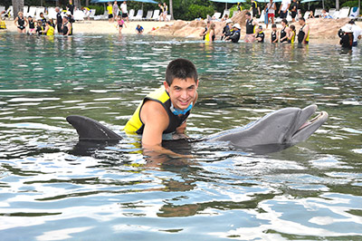 Ramon playing with a dolphin
